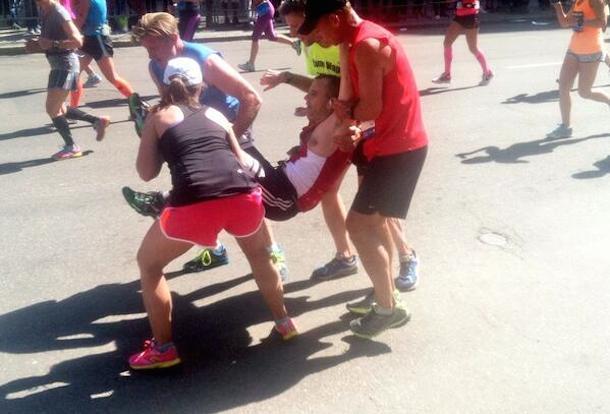 boston marathon feel-good story carrying runner