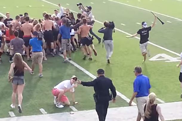 cop trips high school kids rushing field
