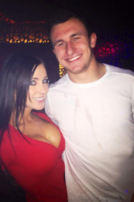1 manziel with cleavage chick in red shirt