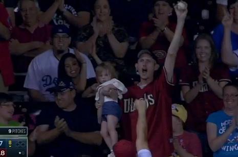Diamondbacks Fan Catches Ball, Holds Baby