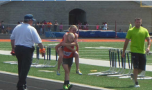 13-Year-Old Carries Twin Sister Across Finish Line in 800m Race (Video)