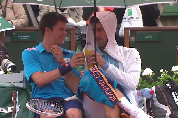 Novak Djokovic having fun with ball boy during rain delay
