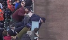 Detroit Tigers Fan Accidentally Moons Crowd While Reaching for Foul Ball (Video)