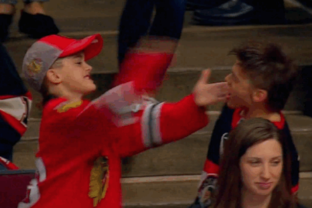 blackhawks kid slapping another blackhawks kid