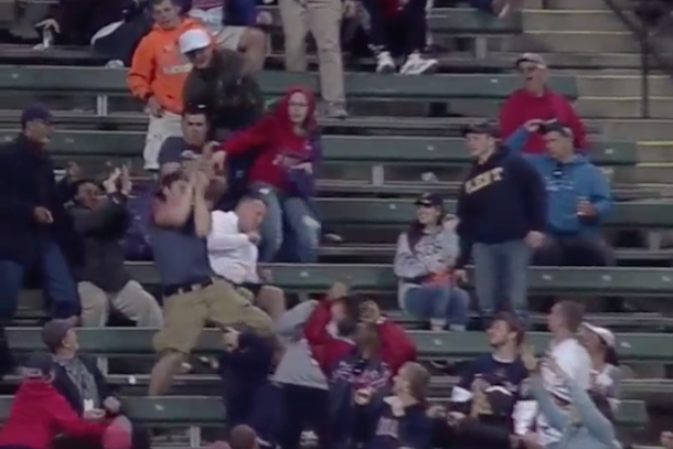 cleveland indians fan takes ball to face