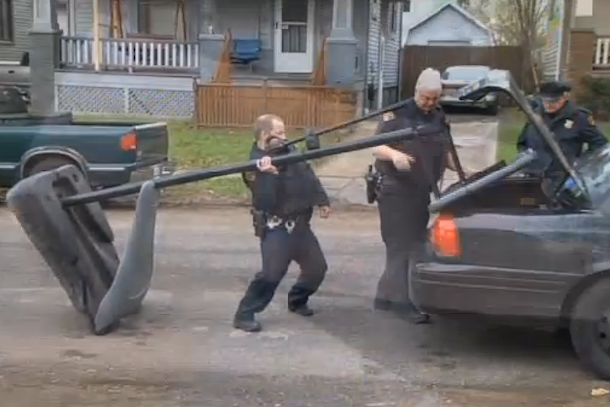 cleveland police confiscate basketball hoop drag it away behind car