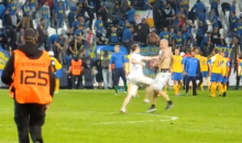 Slovakian Soccer Vigilante Runs Onto Field, Takes Out Other Pitch Invader (Video)
