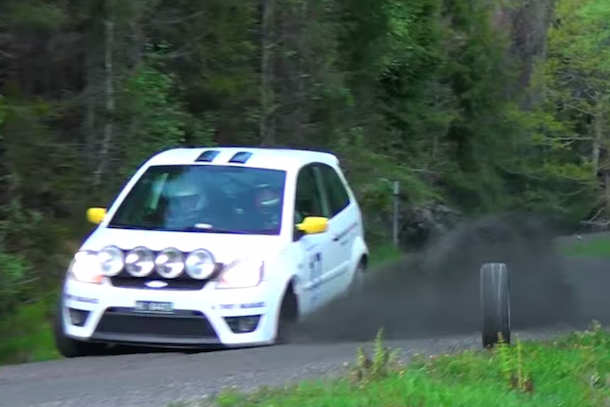 rally car tire nearly hits cameraman
