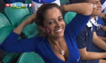 Wise World Cup Cameraman Shoves Male Fan Aside for View of Sexy Female (GIF)