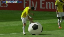 Somebody Interrupted Colombia-Ivory Coast by Throwing a Giant Soccer Ball Onto the Field (GIF)