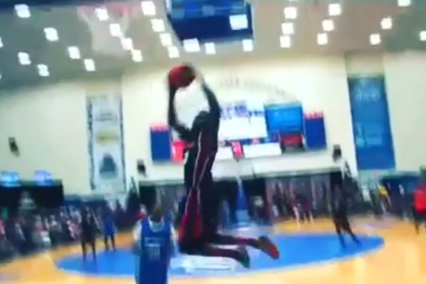 amazing dunk - street baller changes his mind mid-dunk