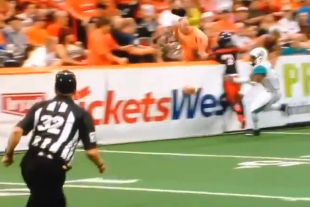 arena football fan gets destroyed leaning over the boards