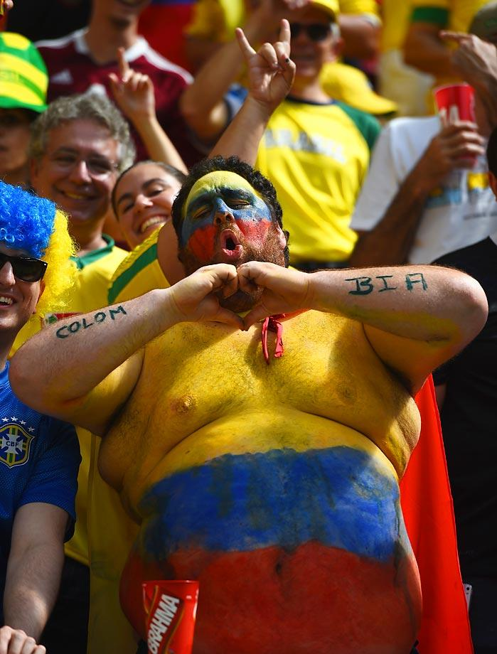 columbia painted fat guy - craziest fans at 2014 fifa world cup