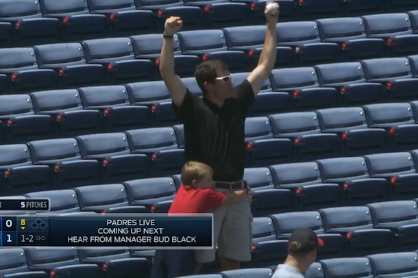 dad catches foul ball for son