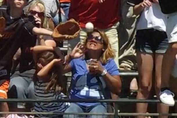giants fan catches home run ball in beer