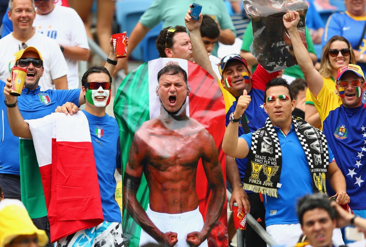 italy fan with balotelli poster cutout - craziest fans at 2014 fifa world cup