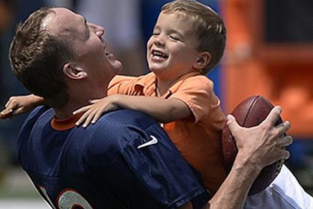 peyton manning tackled by his kids broncos training camp