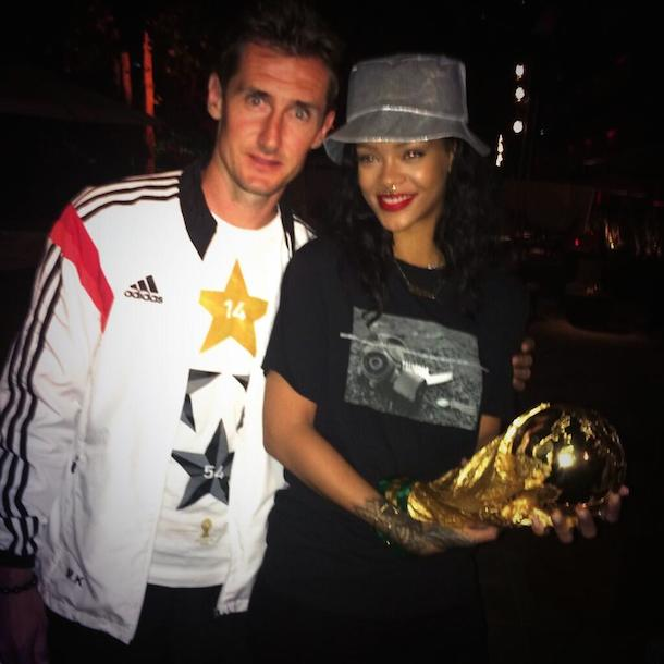 rihanna and miroslav klose with world cup trophy