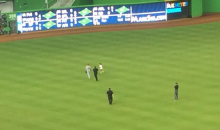 Awesome Little Girl Crashes the  Field in Reds-Marlins Game (GIF)