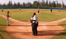 Little League Ump from the Bahamas Performs Funky Dances Between Pitches (Video)