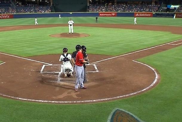 bryce harper drags leg through braves logo behind home plate