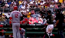 Watch This Unsuspecting Fan Get Hit in the Head by a Flying Baseball Bat (Video)