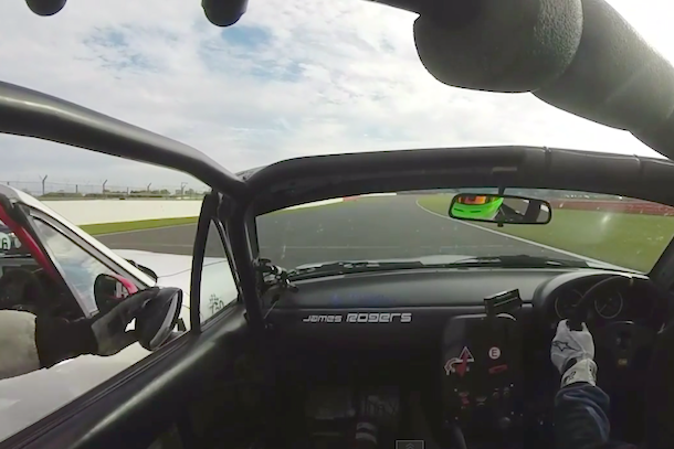 race car driver messes with opponent's rearview mirror