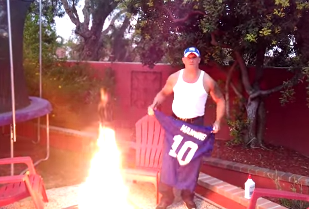 free shipping 6d636 a0b81 Angry Giants Fan Burns Eli Manning Jersey | Total Pro Sports