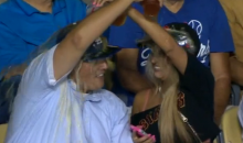 Kiss Cam Couple Inexplicably Dumps Beer on Each Other (Video)