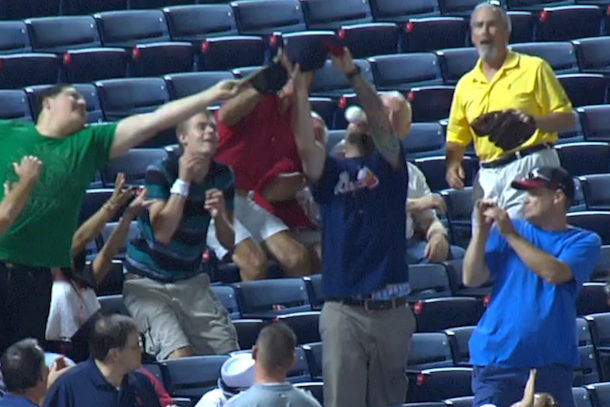 braves fan takes foul ball to the face