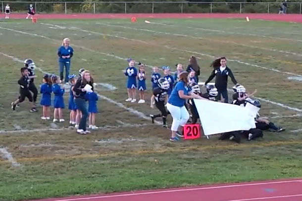 mighty mites football team taken out by banner