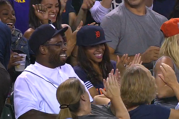 miguel cabrera throws ball to calvin johnson at the tigers game