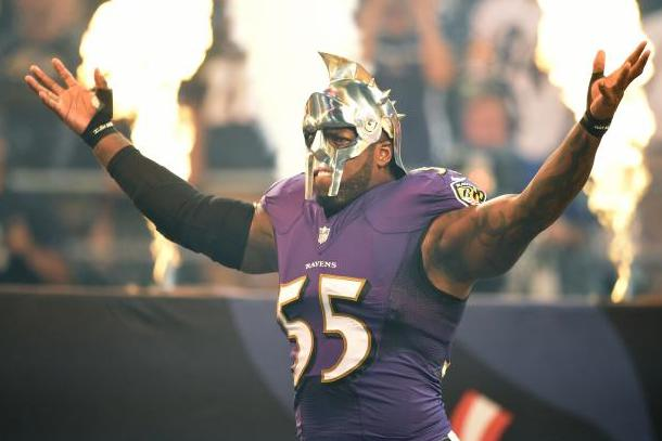 terrell suggs wearing a gladiator helmet