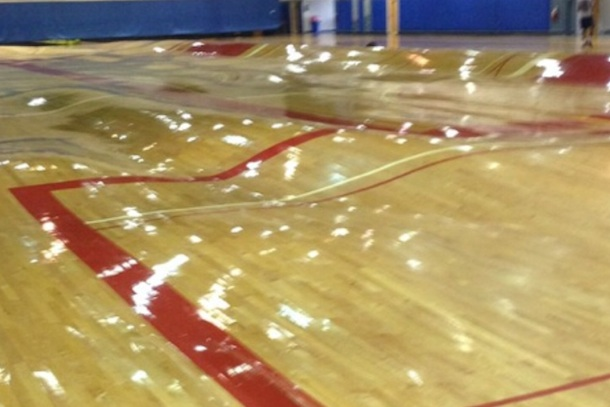 Burst pipes create warped gym floor just like 39 the for How big is a basketball court