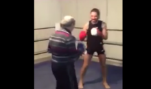 Old Man in a Sweater Kicks Young Guy's Ass in the Boxing Ring (Video)