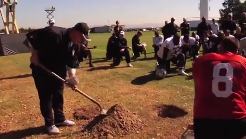 Raiders Coach Tony Sparano bury football
