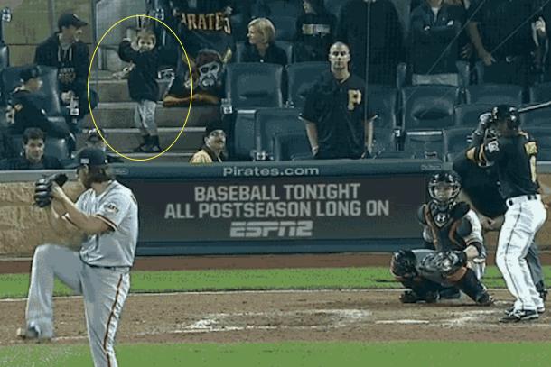 cute pirates kid behind home plate