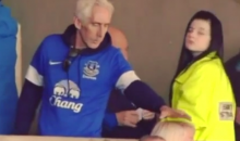 Classy Everton Fan Picks Nose and Wipes Booger on Woman's Head (Video)