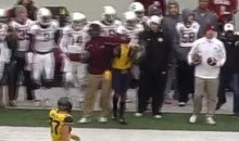 Texas A&M Student Assistant Hits WVU Player on the Sideline (Video)