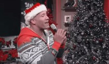 The Rock Sings 'Here Comes Santa Claus' In a Onesie on 'Live With Kelly & Michael' (Video)