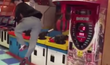 Martial Arts Dude Destroys Boxing Arcade Game with 540º Flying Spin Kick (Video)