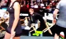 Here's Elton John Falling Out of a Chair at a Charity Tennis Match (Video)