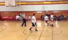 Watch This Basketball Ref Take a Phone Call During a Game (Video)