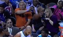 Hornets Fan Takes Ball to the Face While on the Phone (Video)
