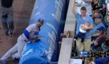 Cubs Fan Catches Foul Ball While Carelessly Holding a Baby (Video)