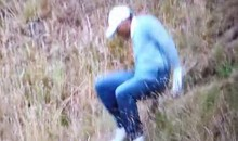 Tiger Woods Falls Over Retrieving a Ball at the U.S. Open (Video)