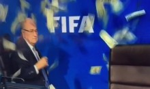 Dude in Suit Makes It Rain on FIFA President Sepp Blatter (Video)
