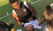Khalil Mack Signs Crying Baby (Photo)