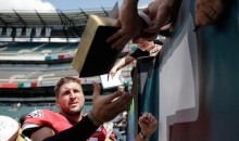 Tim Tebow Signs Bible For a Fan at Eagles Camp (Pic)