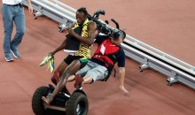 Usain Bolt Wins 200m Race, Gets Leveled by Man on Segway (Video)